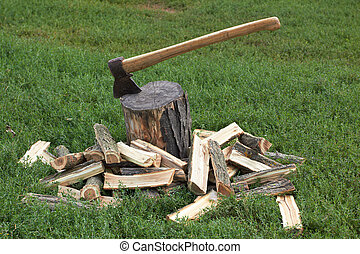 axe - Wooden logs and rusty axe