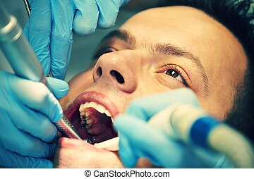 Dentist office - Young man in dentist office - selective...
