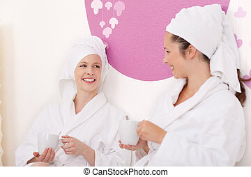 Two friends at the spa enjoying a drink