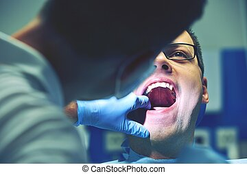 Dentist office - Young man in dentist office