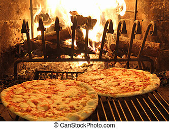 excellent fragrant pizza baked in a wood fireplace 1 -...