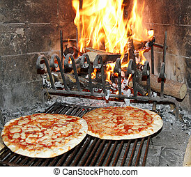excellent fragrant pizza baked in a wood fireplace with a...