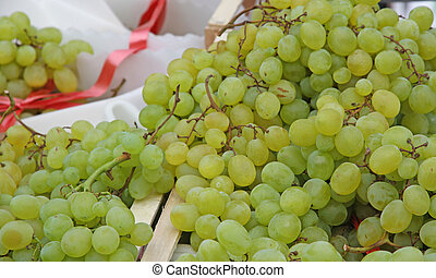 ripe white grapes for sale at vegetable market