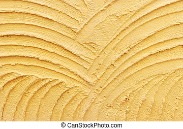Background with orange plaster wall with uneven surface