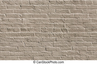 Beige painted brick wall seamlessly tileable background...