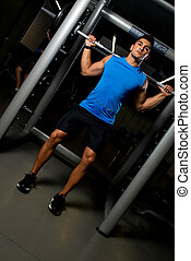 Fitness Trainer Doing Barbell Squat - Health Club Workout...