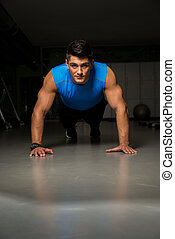 Man Doing Pushups - Portrait of a healthy, young guy doing...