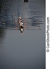Rowing 3 - A rowing team practice rowing in the evening on a...