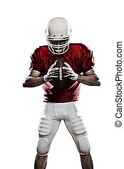 Football Player with a red uniform and a ball in the hand on...