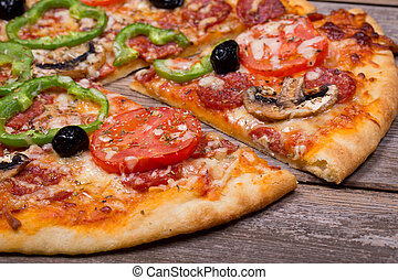 Pizza - Pepperoni pizza with sliced vegetables on rustic...