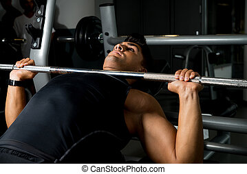 Bench Press Workout - Weightlifter on Benchpress