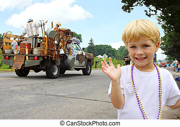Cute Child at Parade - a cute, smiling little boy is waving...
