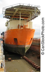 Ship in dry dock - A ship in dry dock before being painted