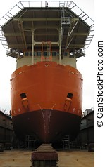 Ship in dry dock - A newly painted ship in dry dock