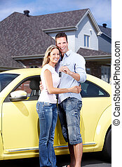 Couple with a car key. - Happy young couple near new car...