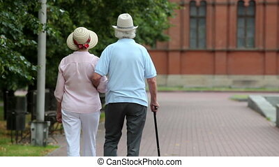 Active retirement - Active retirees taking a walk in the...