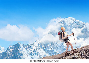 Young woman mountaineer - Pretty young woman tourist...