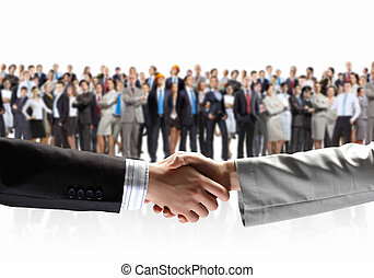Business handshake - Close-up of human handshake with crowd...