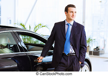 Businessman near car - Image of handsome young businessman...