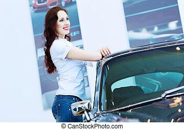Young lady at car salon