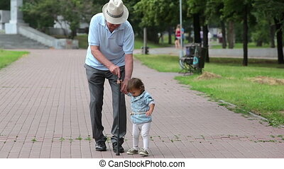 Elderly and young - Grandparents looking after their...