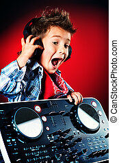 child meloman - Expressive little boy DJ in headphones...