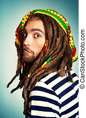 rasta emotion - Portrait of a rastafarian young man.