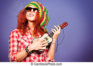 small guitar - Portrait of a rastafarian girl playing her...