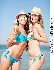 girls in bikinis with ice cream on the beach - summer...