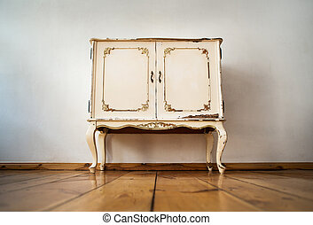 commode - vintage commode in front of a wall