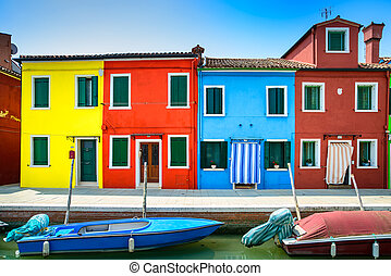 Venice landmark, Burano island canal, colorful houses and...