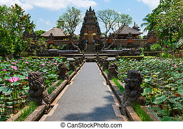 Balinese temple Pura Saraswati in Ubud with lotus flowers in...