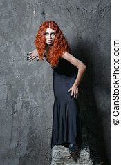Halloween, witch, vampire - Red-haired vampire girl with red...