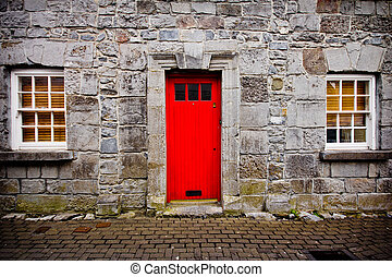 Red Door - Red door on old European stone house