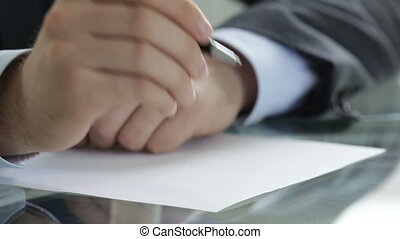 Application - Close-up of a business worker writing an...