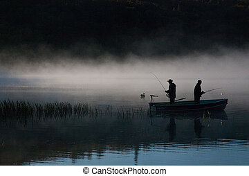 Fishermen in the foggy lake