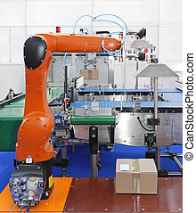 Articulated Robot - Articulated robotic arm at packaging...