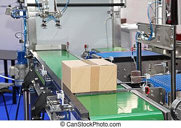 Conveyor belt at packaging line in factory