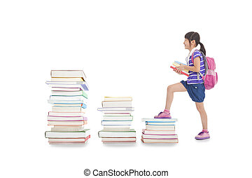 happy little girl with backpack walking to the top of books