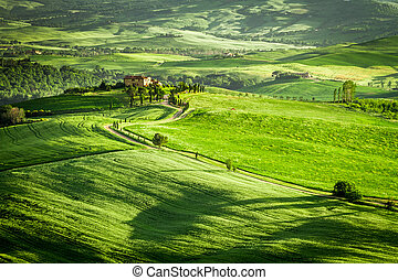 Green fields and meadows with agrotourism in Italy