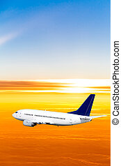 Airplane in the sky at sunset. A passenger plane in the sky