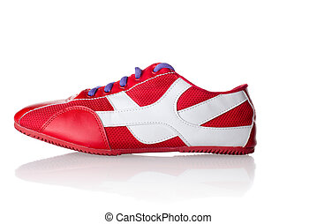 Red athletic sneaker with purple laces - An isolated photo...