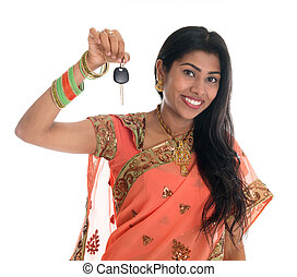 Indian woman holding car key