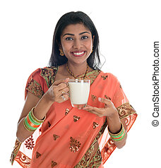 Indian woman in sari drinking milk