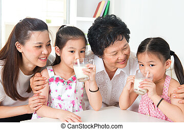 Happy multi generations Asian family at home - Drinking milk...