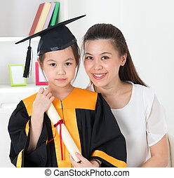 School kid graduation. - Asian school kid graduate in...