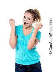 Excited charming girl with clenched fists - Attractive girl...