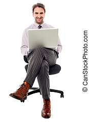 Corporate guy preparing presentaion - Businessman sitting on...