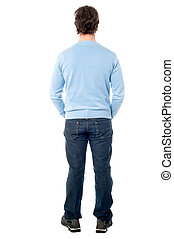 Rear view of a man in casuals - Casual man facing towards...