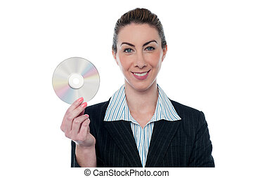 Attractive woman in formals holding CD